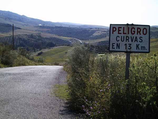 Bord met Peligro Curvas
